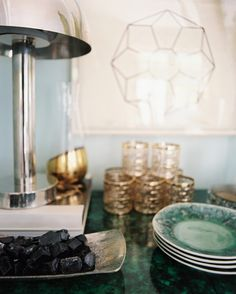 Gold and blue is a great combination,this site helps with matching metals for your decor.