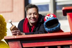 Jimmy and Cookie Monster on the Sesame Street Thanksgiving Parade float
