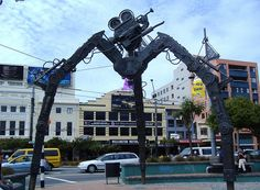 The giant tripod sculpture by Weta Workshop in Courtenay Place, Wellington, New Zealand Capital Of New Zealand, Wellington New Zealand, Places In England, New Zealand Houses, New Zealand Travel, Outdoor Art, Capital City, Public Art, Brighton