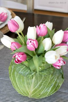 Love this idea for a centerpiece you can make using a cabbage and tulips from the grocery store! centerpieces Setting a Simple Easter Table (With Decorations You Can Snag at the Grocery Store! Vasos Vintage, Easter Table Decorations, Easter Centerpiece, Easter Decor, Easter Ideas, Easter Table Settings, Party Table Centerpieces, Dessert Tables, Driven By Decor