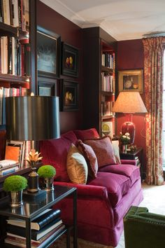Room of the Day: other half of this cosy English sitting room with deep pink sofa - love the greenery - Paolo Moschino 10.30.2013