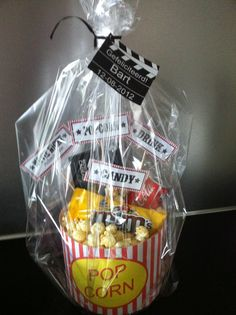 Giftbasket for a movie night....I made one a d bought the big candy boxes they sell in the theater at either bed bath and beyond with the popcorn tub differ sizes or buy yhe candy at the $1store. I put a pack of popcorn pluse candy and added a gift card to the movies for 2.