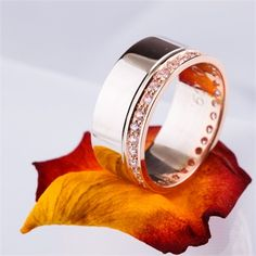 Large wedding band with rose gold and diamond detail