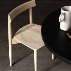 In natural finish or sleek black lacquer, L. Ercolani's solid ash wood chair is as sturdily practical as it is crisply stylish. #AplusR #moderndesign #interiordesign #modernchair #woodenchair #diningroomideas #diningroomchair #Lercolani