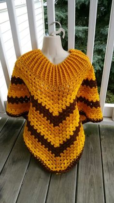 Hot Off My Hook! Project: Cowl-Neck Poncho Started: 30 Sept 2015 Completed: 03 Oct 2015 Model: Madge the Mannequin Crochet Hook(s): 7mm, Cowl portion J, Granny Stitch Yarn: Redheart Super Saver Bernat Super Value Color(s): Gold, Bright Yellow, Walnut Pattern Source: Simply Crochet Magazine Issue No. 25 Pattern Designed By: Simone Francis Notes: This is my 31st Cowl-Neck Poncho! I was happy to oblige a Father who asked if I could make this for his teenage Daughter.