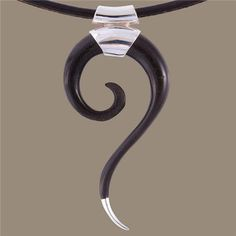 Bone And Silver Horn Pendant - Tribal Jewelry -Tribal Spiral Jewelry - Horn Necklace - Horn Jewelry - Unique Jewelry  Elongate spiral horn pendant, tipped off in silver.  The spiral represents evolution and holistic growth.   Don't forget to choose which leather chain you like to add to the pendant.  $44