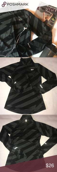 Nike - Dri Fit Black Pattern Quarter Zip - Small This quarter zip is in good, used condition! It's a women's small, and is SUPER comfy! It has a black and grey pattern on it, similar to stripes/ chevron/ or lightening bolts. It has reflective features which you can see in the pictures I used the flash in! 100% polyester! Nike Tops Sweatshirts & Hoodies