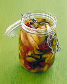 Pickled Cucumbers and Jalapeños | Martha Stewart Living - Jalapenos range from mild to strong -- in either case, they make fantastic pickles.