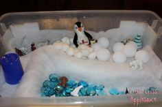 "Another Polar Region Project- glass pebbles, cotton wool balls, polystyrene balls, cups, cardboard tubes, quilt batting, polar animals ("",)"