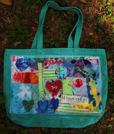 Fabric collage on old tote bag by mosaicfun, via Flickr