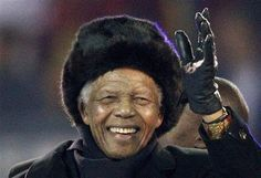 GO WELL AND GET WELL MADIBA . . WE LOVE YOU!!! Former South African President Mandela waves to crowd at Soccer City stadium during the closing ceremony for the 2010 World Cup in Johannesburg