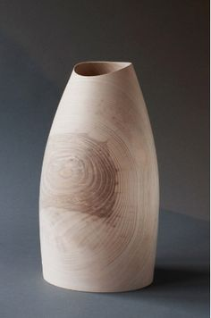 Liam Flynn has been making wood vessels in his Co. Limerick studio for 25 years. His work has evolved over the course of his career from smaller explorations of open vessels to his current work exploring volume, shape and line. His works are a regular feature on the international circuit marking him as one of the most accomplished wood turners of recent times.