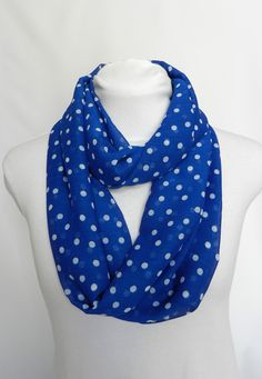Give your outfit a classic look with this blue and white polka dot infinity scarf. Its lightweight chiffon fabric is soft and has beautiful flowing drape. This scarf will make a great addition to your fall wardrobe.