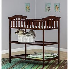 """The Dream on Me Marcus Changing table and dresser is a handsomely designed piece of juvenile furniture that compliments any nursery. This beautifully constructed changing table features a safety rail, changing pad, and restraining strap with an easy release buckle to secure baby safely in place. The 3 easily accessible, spacious drawers beneath accommodate the baby's wardrobe and essentials for added convenience. All tools for assembly included. Assembled Dimensions: 35""""x18""""x9"""""""