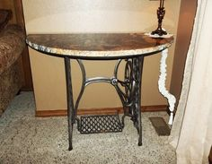 granite top table with sandblasted treadle sewing machine base