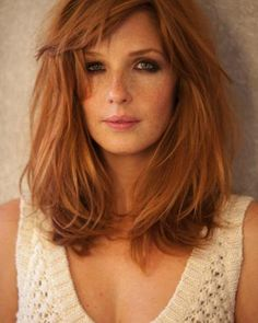 Jenna....a fiery redhead mother of a bit named John. shoes 37. has hazel eyes and freckles. she's Richarts love