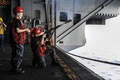 RED SEA (Sept. 9, 2013) – Gunner's Mate 3rd class Joseph Janelle, right, of Apple Valley, Calif., shoots a line over to the Military Sealift Command fast combat support ship USNS Rainier (T-AOE 7) during a replenishment-at-sea aboard the aircraft carrier USS Nimitz (CVN 68). (U.S. Navy photo by Mass Communication Specialist Seaman Siobhana R. McEwen/Released)