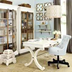 We combined soft, silver blue with hints of gold to create a feminine office space you most certainly won't mind spending time in.
