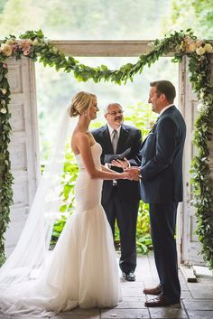Ceremony with door arch and floral garland | Nick Edmundson Imaging | Real Wedding as seen on TodaysBride.com
