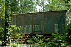 Completed in 2005 in São Paulo, Brazil. Images by João Nitsche. This shelter design at the open Atlantic coast rainforest in the State of Sao Paulo is an opportunity to think home considering its essential. Forest Cabin, Forest House, Jungle House, Farm House, Architecture Details, Interior Architecture, Shelter Design, Garden Studio, Lake Cottage