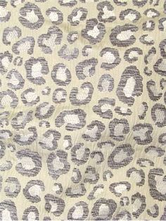 "Sarafina Leopard Silver - Thick and soft chenille accent leopard jacquard fabric. Perfect for upholstery fabric or any home décor fabric project. 100% polyester. 14"" up the roll repeat. 54"" wide. Cleaning code; S."