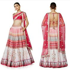 An exquisite floral hued digital printed lehenga with traditional machine embroidered raw silk choli and a berry pink bordered net dupatta.  Code : S1006 Title : The Paree Lehenga Choli & Dupatta. Size : Free Color : Pink Fabric : Raw Silk Type : Embroidered Printed. Occasion: Festive Wedding Ceremony Party Neck Type: Round Neck Sleeve Type: Short Sleeve Price : 2500 INR  Shipping For Order DM Or WhatsApp On 91 9054562754
