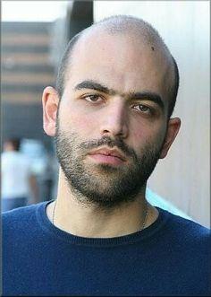 Saviano Pasolini, Italian journalist and activist, was my visual model for Alexi's nemesis, Carmine Mercurio. Beard No Mustache, Character Design Inspiration, Face, Model, Eyeglasses, Scale Model, Pattern, Faces