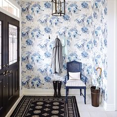 """Designer Vanessa Francis   A unified front Wrapping the entryway in a large-scale soft-blue floral wallpaper gave it the character that many modern homes lack. Francis elevated the look by painting the basic white door black. """"It goes with everything and makes the space feel special,"""" she says."""