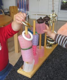 So simple. Dowels on a board, with various cylindrical accessories, great exploration for toddlers.