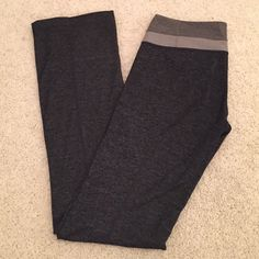 LULULEMON Charcoal Gray Yoga Pants Size 8 These beautiful charcoal grey pants are super soft and in excellent condition! The waist band features 2 other grey colors and the lulu symbol is on the back. Size 8. Only minor flaw is that the hem is beginning to come out in a few places, but lulu offers free hemming so it isn't a problem! No trades, make me an offer! lululemon athletica Pants