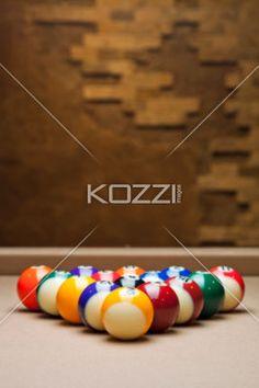 shiny pool balls arranged on table. - Shiny colorful pool balls arranged on pool table in a macro image.