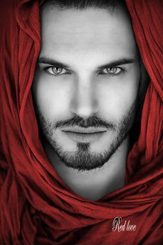 Persephone notices that he has his hooded crimson silk cloak on, the hood drawn enough to shade his eyes from view; one cannot look directly into the Crimson King's red eyes.