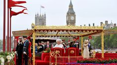 Queen Elizabeth II, centre left, and Prince Philip, centre right, with other members of the royal family watch the proceedings from on board the royal barge during the Diamond Jubilee Pageant on the River Thames in London on Sunday, June 3, 2012. (AP /John Stillwell)