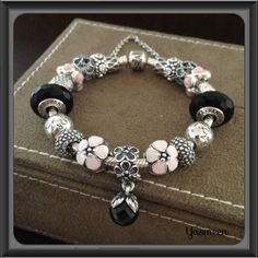 PANDORA Bracelet with Pretty Pink and Black.