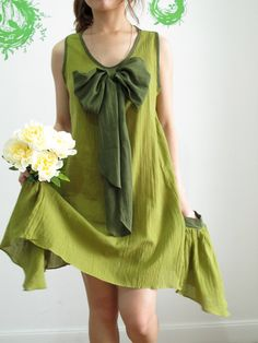 Little Mermaid Emerald Green Dress with Flutter Tail Pockets and Super Cute Bow - Etsy, $38     would be a great preggo dress.