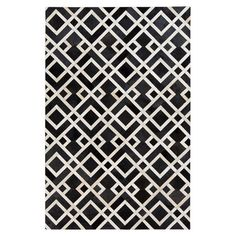 Showcasing a geometric trellis motif, this handcrafted rug is equally at home anchoring your dining table or placed in the living room.