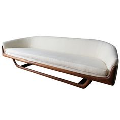 Vintage Mid-Century Sofa by Adrian Pearsall  USA  Mid-Century  This beautiful vintage Model 2834 sofa by Adrian Pearsall has a sculptural walnut base and cream colored upholstery.