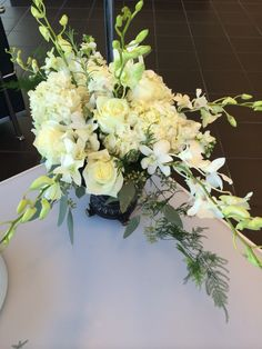 Orchid and roses, oh my. Elegant centerpiece. Holland Daze Weddings