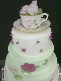 English tea party cake with painted roses, and a completely edible teacup!