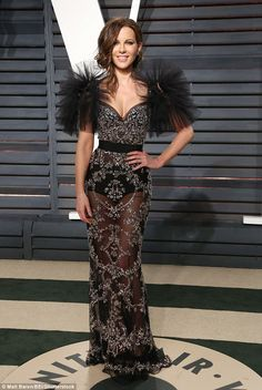 Sheer delight: Kate Beckinsale brought the drama in a plunging semi see-through gown as sh...