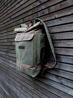 Waxed canvas rucksack / waterproof backpack by treesizeverse $175..... not really water proof, but has nice number of pockets, side pockets and padded laptop compartment
