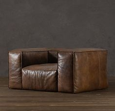 Madly in love with this leather chair. this is a 'naked' chair; something one would lie about in, in just the skin.