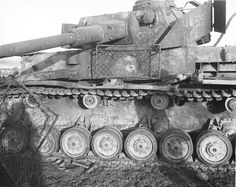 Panzerkampfwagen IV with three half-inch holes through the armor from M1 Bazooka anti-tank rockets near French-German border 2 January 1945.