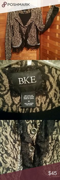 LADIES BUCKLE JACKET LACE TAN BLACK ANIMAL SZ M Super cute jacket from the Buckle. Tan & black animal like print embelished with black lace ruffle brass buttons and raw edge brown and white floral print fabric. Size M. Has stretch to it. Buckle Jackets & Coats Blazers