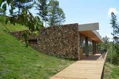 homes on hillsides | The rock walls project from the hillside like an archaeological relic ...
