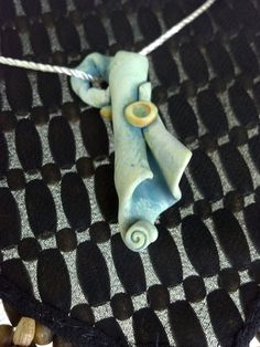 Sealed Scroll Handcrafted Polymer Clay Pendant with Acrylic Wash. $20.00, via Etsy.