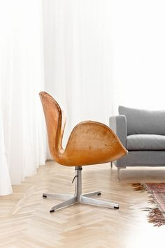 tan leather swan chair love it!