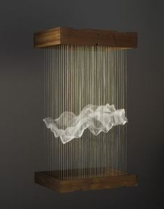 MAGGIE CASEY: Hanging Cloud, thread, silk organza, copper tacks, wood, 2006. Casey creates mathematical structures informed by her education in weaving. She refers to these structures as 'hanging tapestries'