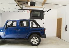 Harken Hoister Do you want to remove your hardtop on your Jeep Wrangler but don't have anyone around to help you lift it off? The Harken Hoister is made for you! The Harken Hoister is a lift system that uses a series of self locking ball Overhead Garage Storage, Garage Storage Systems, Jeep Wrangler Yj, Jeep Rubicon, Jeep Jku, Jeep Hardtop Storage, Accessoires Jeep, Jeep Hard Top, Jeep Tops