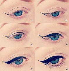 Winged eyeliner - liquid eyeliner is definitely the go here.